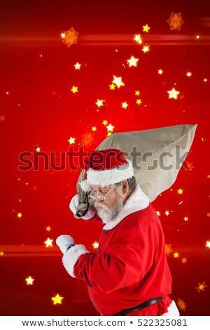 Mikulás néz karóra tart zsák tele Stock fotó © wavebreak_media