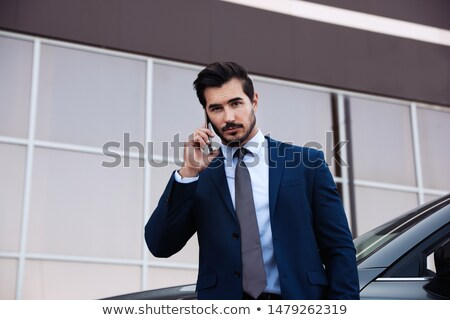 Low angle portrait of young man in suit Stock photo © IS2