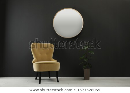 Modern yellow soft armchair with upholstery - interior design element isolated on white background. Stock photo © MarySan