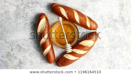 Three loafs with bowl of honey in middle Stock photo © dash