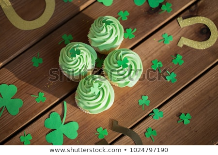 green cupcakes, horseshoes and shamrock Stock photo © dolgachov