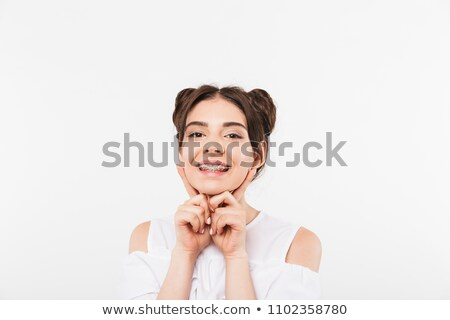 portrait closeup of joyful smiling girl 20s with double buns hai stock photo © deandrobot