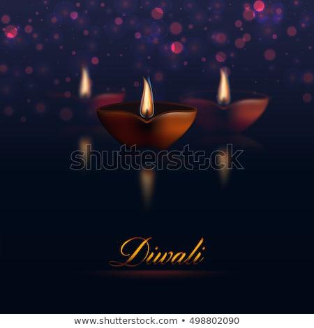 three diwali diya with fireworks Stock photo © SArts