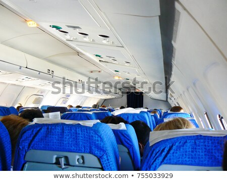 Interior of commercial airplane with passengers in their seats Stock photo © lightpoet