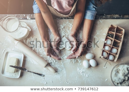 happy mother and daughter making cookies at home stock photo © dolgachov