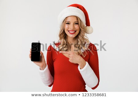 Stock photo: Emotional excited young cute snow maiden showing display of mobile phone isolated.