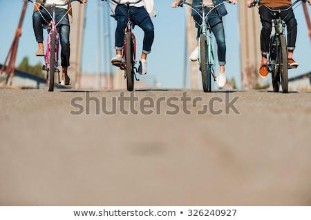 Young friends cycling in a row Stock photo © Kzenon