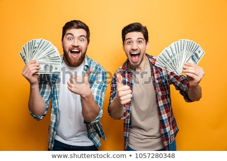 businessmen with cash, rich people. two men joyful Stock photo © studiostoks