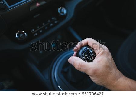 Business man driver hand shifting Stock photo © deandrobot