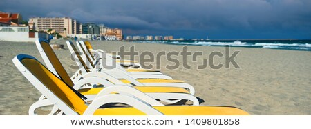 horizontal image cropped view yellow blue color empty sunbeds de stock photo © amok