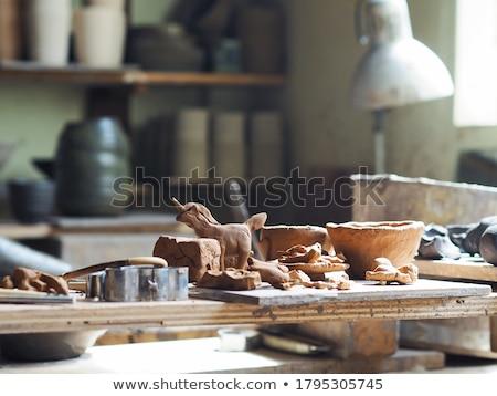 Argila jovem mestre cerâmica superfície da água Foto stock © pressmaster