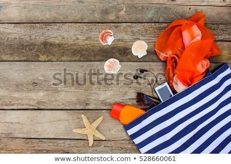 Sunglasses, Seashells And Handbag On Beach Stock photo © AndreyPopov