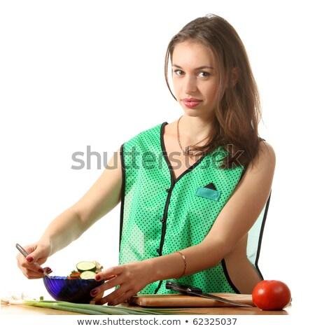 Pretty girl shuffle a salad . Stock photo © fanfo