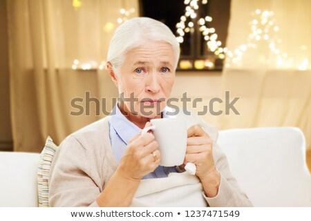 Ongezond senior vrouw drinken thee christmas Stockfoto © dolgachov