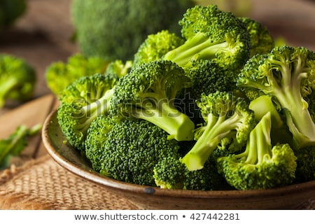 Healthy Green Organic Raw Broccoli Florets Ready for Cooking.  Stock photo © Illia
