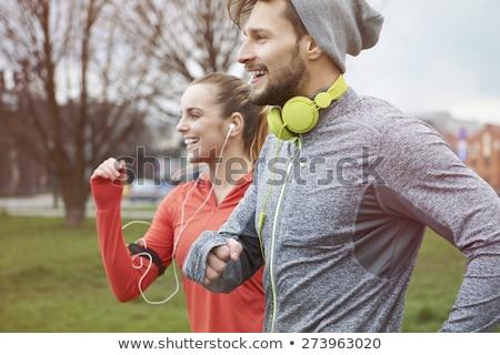 Para słuchawki uruchomiony odkryty sportu ludzi Zdjęcia stock © dolgachov