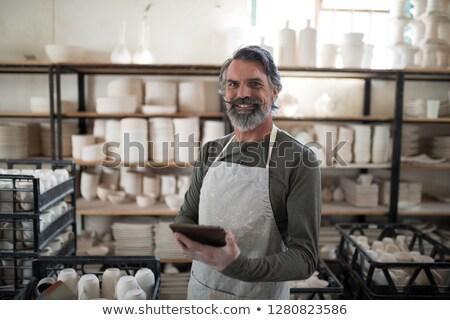 Gülen tablet çalışmak çanak çömlek atölye iş Stok fotoğraf © wavebreak_media