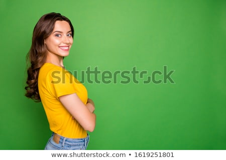 Cheerful woman on green background Stock photo © Lopolo