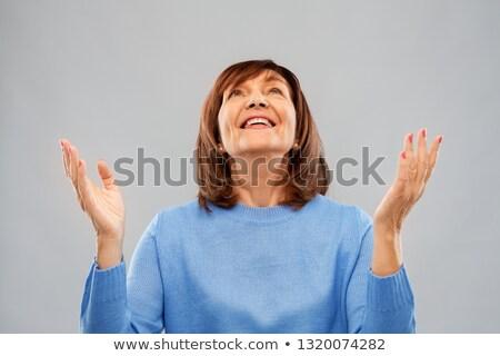 Glücklich Senior Frau nachschlagen dank Gott Stock foto © dolgachov