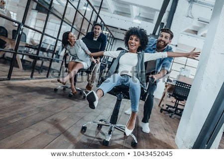 Fiatal üzletemberek okos lezser visel szórakozás Stock fotó © boggy