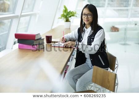 Pracowity dziewczyna okulary praca domowa laptop uczennica Zdjęcia stock © pressmaster