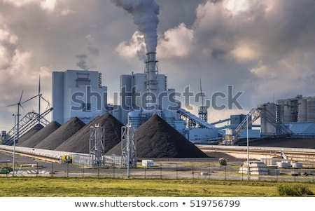 Coal power plant or factory pipes with smoke. Stock photo © ShustrikS