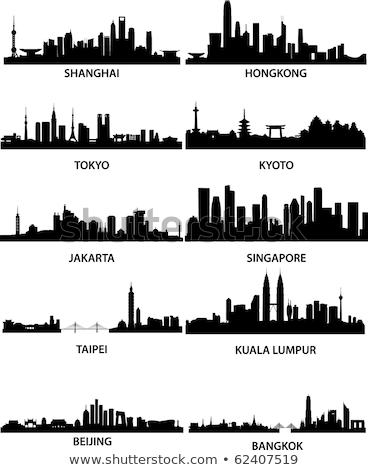 Asia skyline silhouette with different landmarks. Stock photo © ShustrikS