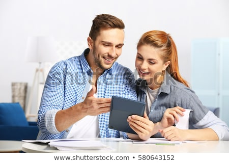 Couple Calculating Tax And Budget Stock photo © AndreyPopov