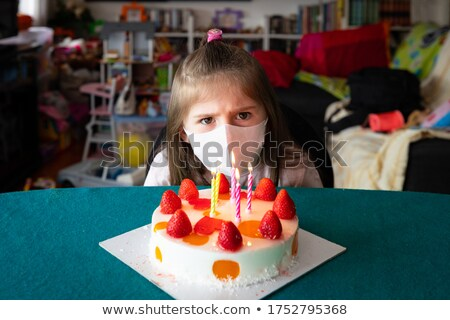 Young girl wearing a face mask on her birthday Stock photo © Giulio_Fornasar