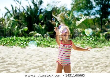 Dziewczyna bańki mydlane summertime podróży plaży Zdjęcia stock © Anneleven