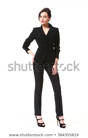 Attractive young woman in a black dress and white jacket stock photo © filipw
