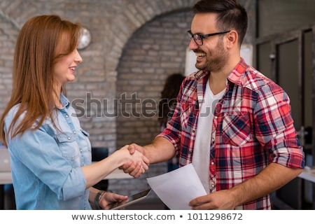 Handshake, Handshaking on Tablet PC Computer Stock photo © adamr