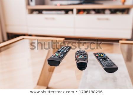 Controle remoto mesa de café livro tiro Foto stock © devon