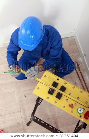 Plumber making measures on a workbench, top view Stock photo © photography33