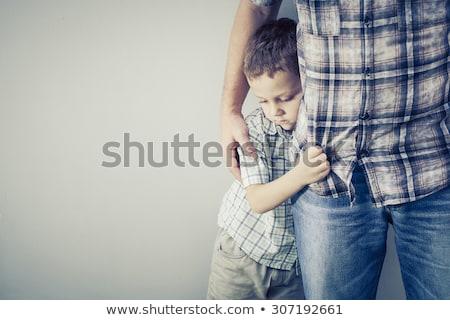 Tímido criança pequeno menino azul Foto stock © ivonnewierink