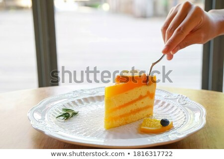 Hand with spoon and one piece of cake Stock photo © pinkblue