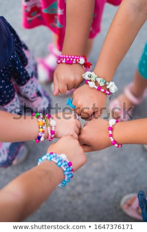girl in bracelet Stock photo © zastavkin