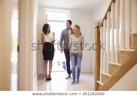 estate agent showing couple around house stock photo © photography33