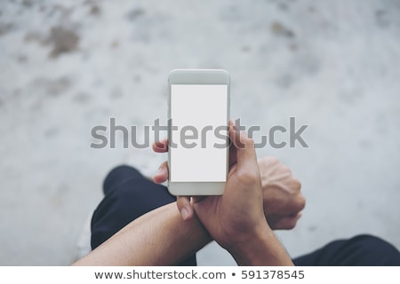 Man topping up phone Stock photo © photography33