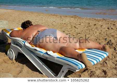 overweight woman sunbathe on beach Stock photo © Mikko