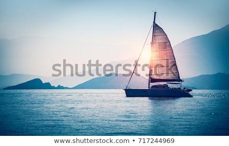 Yelkencilik tekne gün batımı gökyüzü su bulutlar Stok fotoğraf © inaquim