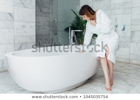 Body care: Young woman in bathroom Stock photo © CandyboxPhoto