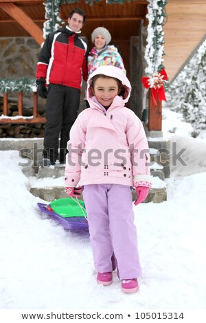 couple posing with daughter near chalet at ski resort Stock photo © photography33