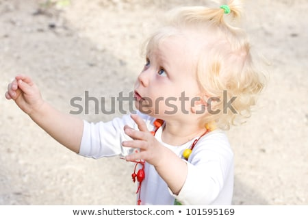 Adorable blonde baby asking for her toys Stock photo © stockyimages
