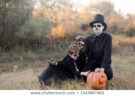 Sugar skull girl in tophat in the forest  Stock photo © Elisanth