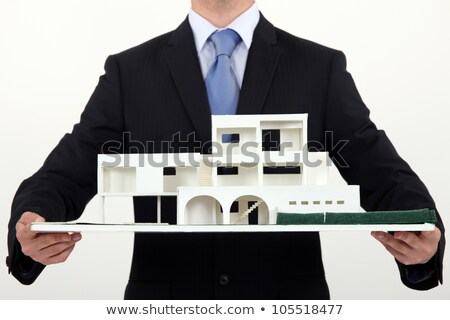 Architect holding scale replica of building Stock photo © photography33