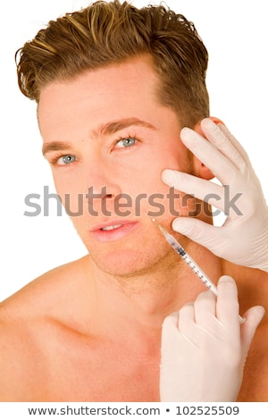 young man doing botox injections stock photo © ambro