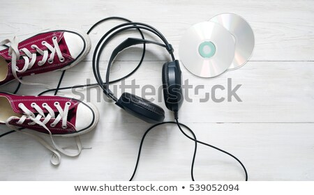 Teenagers listening to CDs on headphones Stock photo © photography33