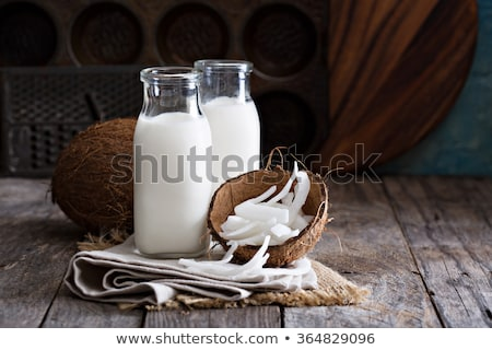 coconut with glass of milk stock photo © m-studio