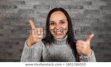 thumbs up! Young woman happily says OK Stock photo © stokkete